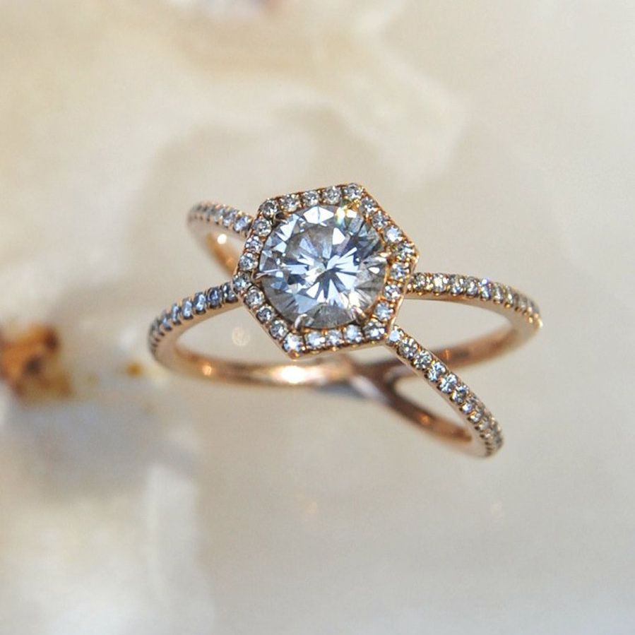 X-style pavè band ring with a hexagon-shaped halo with round center stone