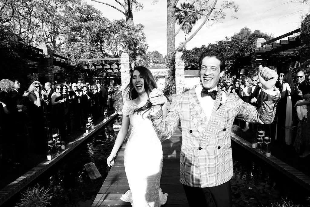 minimalist california wedding, bride and groom holding hands ceremony