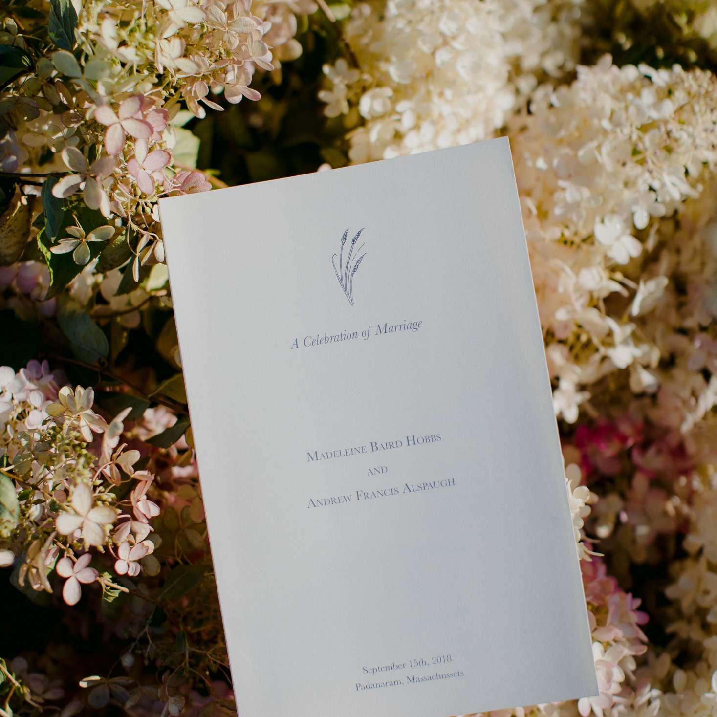 at-home rustic massachusetts wedding, ceremony program against flowers